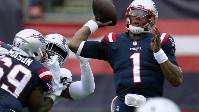 New England's Cam Newton passes under pressure in the first half of Sunday's win over Las Vegas.
