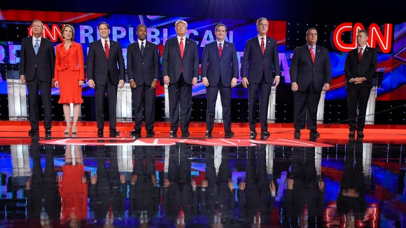 Republican presidential candidates take the stage during