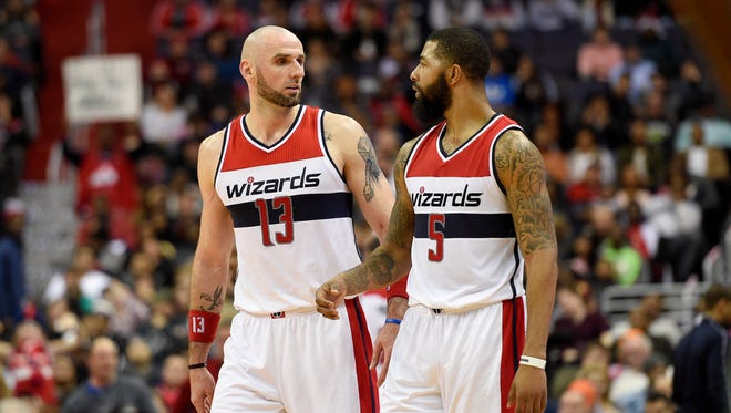 Washington Wizards center Marcin Gortat (13), of Poland, talks with Markieff Morris (5) during the second half of an NBA basketball game against the Milwaukee Bucks, Monday, Dec. 26, 2016, in Washington. The Wizards won 107-102.
