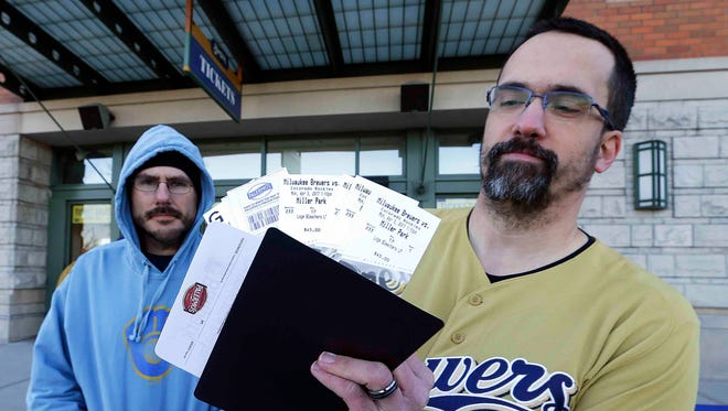 Christopher Witt (yellow shirt) and Christopher Arndt, both from West Bend, were among a few hundred fans who turned out at Miller Park on Saturday to buy their single-game tickets for the Milwaukee Brewers' 2017 season.  With temperatures well-above February norms in the the low 50's, it was more like a late spring game day than normal.