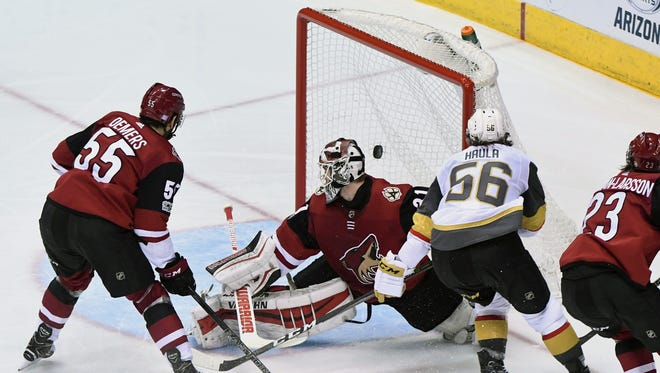 Nov 25, 2017; Glendale, AZ, USA; Vegas Golden Knights left wing Erik Haula (56) scores a power play goal on Arizona Coyotes goalie Scott Wedgewood (31) during the second period  at Gila River Arena.