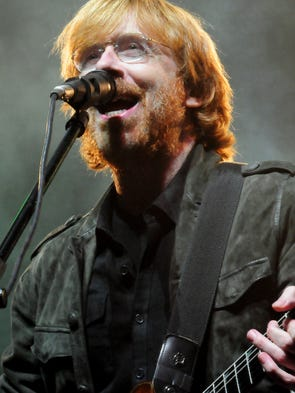 Phish front man trey anastasio performs during a benefit concert at