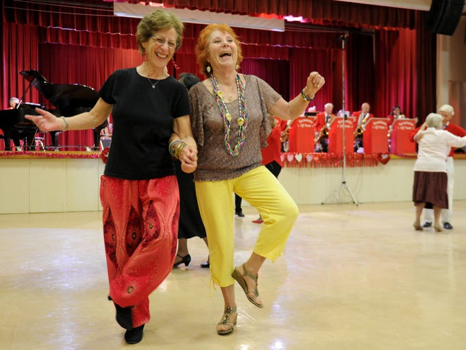 Rosanna Brown, left, and Andrea Moran dance a polka