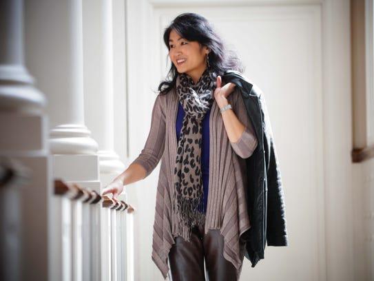 Pianist Hiroko Yamazaki wears brown Gap leather pants,