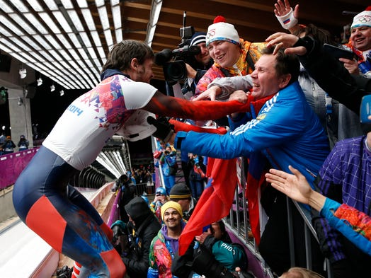 Alexander Tretiakov (RUS) reacts after winning gold in men's skeleton.