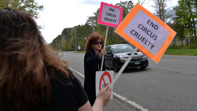 Gabrielle Carleen of Manahawkin (left) and Lisa Morse-Morrison of Port Norris protest the Zerbini Family Circus outside the New Jersey Motorsports Park in Millville.