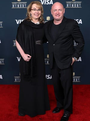 Former congresswoman Gabby Giffords and husband Mark Kelly arrive on the red carpet prior to the sixth annual NFL Honors at Wortham Theater on Feb. 4, 2017, in Houston.