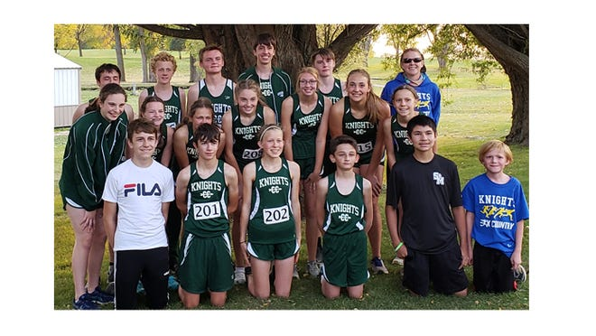 A happy Cross Country team after the Oct. 8 meet with GFW.