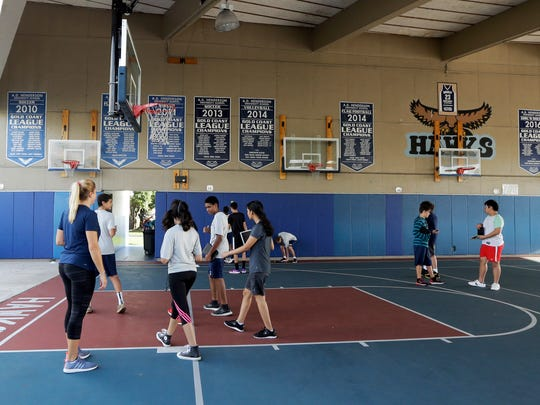 In this photo taken Wednesday, Sept. 7, 2016, students participate in exercises at Florida Atlantic University in Boca Raton, Fla. The high school's athletic program has the usual sports except football (don't want these prized brains getting concussed, Assistant Dean Joel Herbst said) and baseball and softball (not enough interest).
