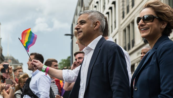 London Mayor Sadiq Khan, and his wife Saadiya Khan lead the Pride March as the LGBT community celebrates in London on June 25, 2016.