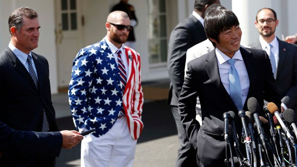 Red Sox pitcher Koji Uehara speaks with the media as manager John Farrell (left) and Red Sox outfielder Jonny Gomes (middle) listen in front of the West Wing of the White House after a ceremony honoring the 2013 World Series champions  on April 1.