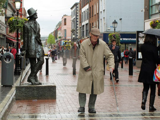 In this April 26, 2012 file photo, a man walks past the statue of author James Joyce on the main shopping boulevard of Dublin, Ireland.