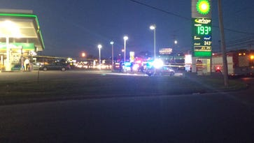 Police respond to a shooting Tuesday at the BP on Wilma Rudolph Boulevard.