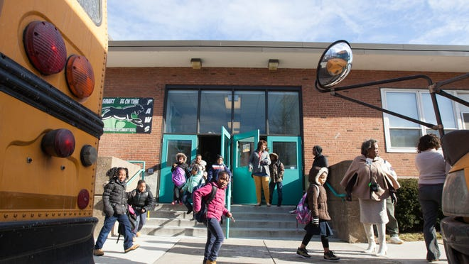 Students are dismissed from Stubbs Elementary School on Tuesday. Stubbs is one of three Christina schools that face closure if they do not hand operations over to charter schools or other education management organizations.