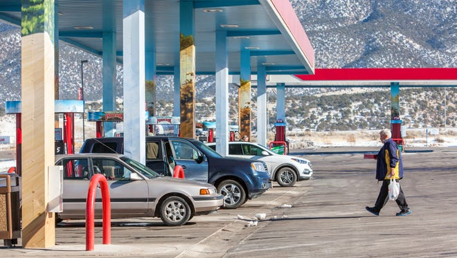 People fill up on gas at a Maverick in Cedar City, Tuesday, Dec. 20, 2016.
