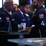 Traders work on the floor of the New York Stock Exchange on Sept. 11, 2013.