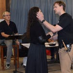 """Brian Deedrick watches as Claire Coolen and Joshua Kohl rehearse a scene from 'Pirates of Panzance."""""""