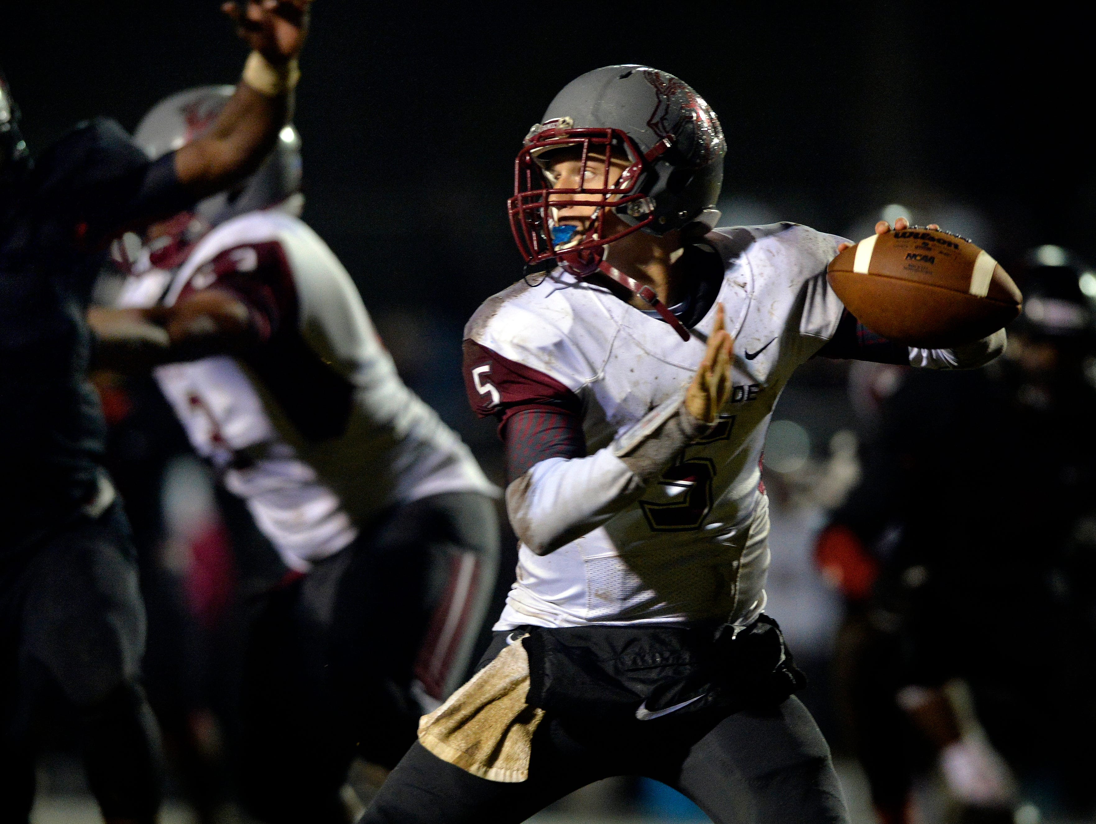 Westside quarterback Jackson Williamson (5) drops back to pass against Hillcrest in a Region 1-AAAA game at Hillcrest High School on Friday, October 2, 2015.