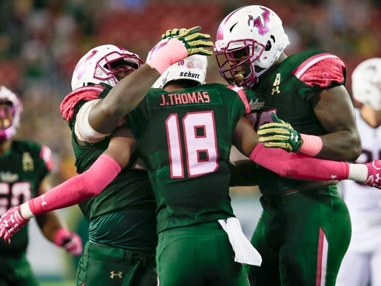 South Florida Bulls safety Jaymon Thomas (18) is congratulated