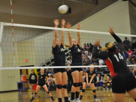 Ruidoso's Andee Roach and Grace Hooker go for the block.
