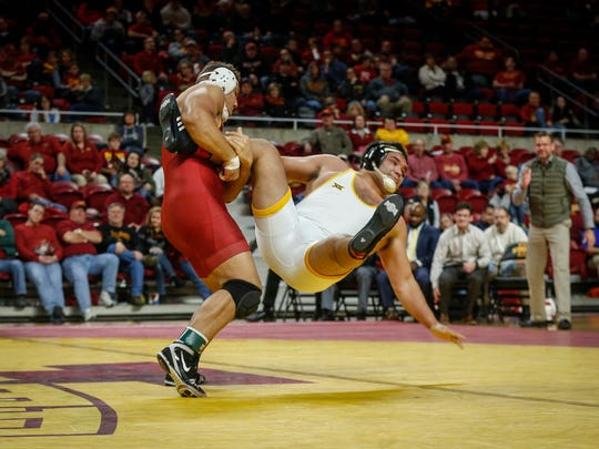 Iowa State heavyweight Marcus Harrington scores a takedown against Wyoming's Hunter Mullins at Hilton Coliseum in Ames on Saturday, Dec. 9, 2017.