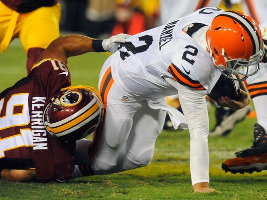 Washington Redskins outside linebacker Ryan Kerrigan (91) sacks Cleveland Browns quarterback Johnny Manziel (2) during the first half of an NFL preseason football game Monday, Aug. 18, 2014, in Landover, Md. (AP Photo/Richard Lipski)
