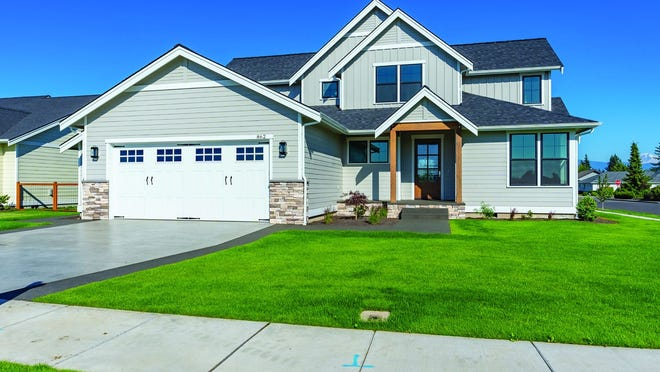 Curb appeal abounds with this modern farmhouse plan.