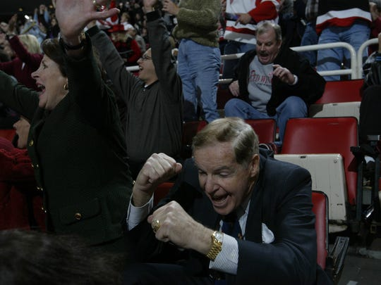 Dr. John Finley, team doctor for the Red Wings, and his wife, Genevieve, celebrate Sergie Fedorov's overtime game-wining goal against  Anaheim at Joe Louis Arena on November 15, 2002.