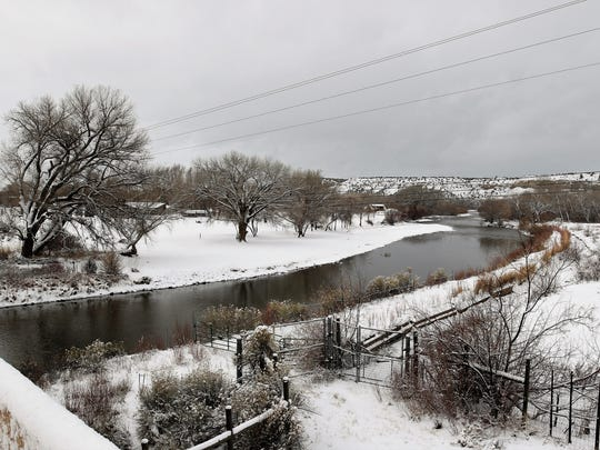 Snow blankets the ground adjacent to the Animas River Monday near Cedar Hill.