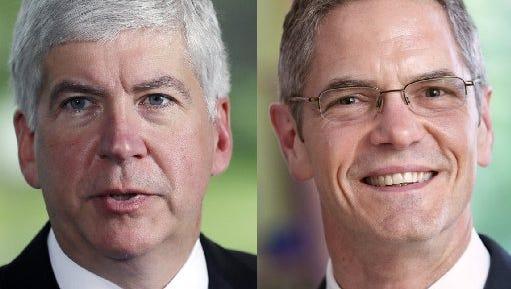 Gov. Rick Snyder (left) and former Democratic congressman and state lawmaker Mark Schauer.
