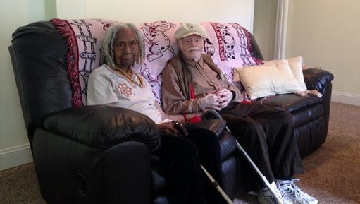 This photo shows 96-year-old Edith Hill and 95-year-old Eddie Harrison in their home in Annandale, Va. The two have been companions for more than a decade after a Hollywood-style meet-cute _ they struck up a conversation while standing in line for lottery tickets, with one of the tickets turning into a $2,500 winner. They married earlier this year, with a 95-year-old church elder presiding over the ceremony, no less.