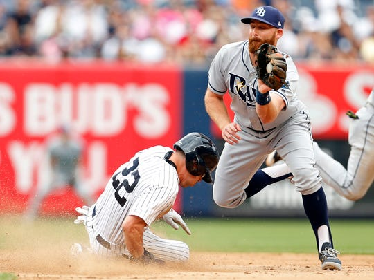 New York Yankees center fielder Jacoby Ellsbury (22) steals second base in front of Tampa Bay Rays second baseman Brad Miller (13) during the ninth inning at Yankee Stadium on Saturday, July 29, 2017.
