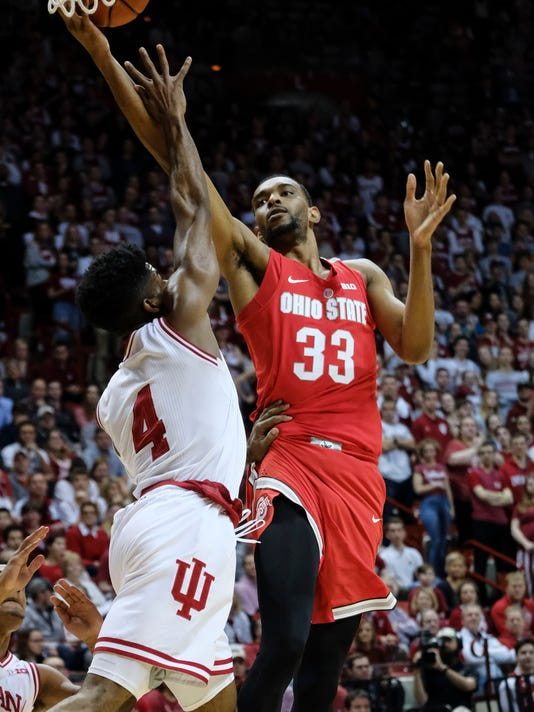 Ohio State forward Keita Bates-Diop (33) shoots in front of Indiana guard Robert Johnson (4) during the first half of an NCAA college basketball game in Bloomington, Ind., Friday, Feb. 23, 2018. (AP Photo/AJ Mast)