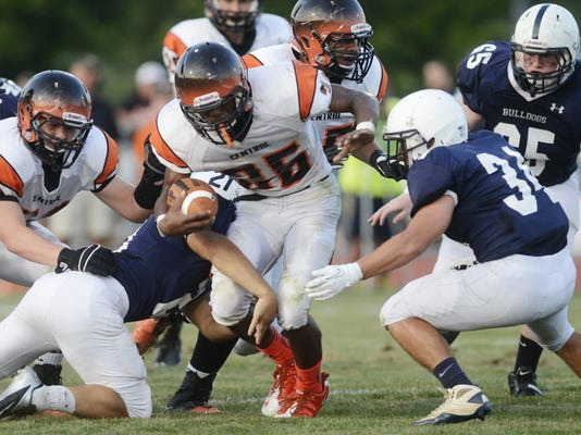 Central York's Breaun Randle emerges from the pack during Week 1 of the high school football season at West York. Central York won, 41-6, and moved up to No. 2 in the YAIAA football power rankings. (DAILY RECORD/SUNDAY NEWS -- KATE PENN)