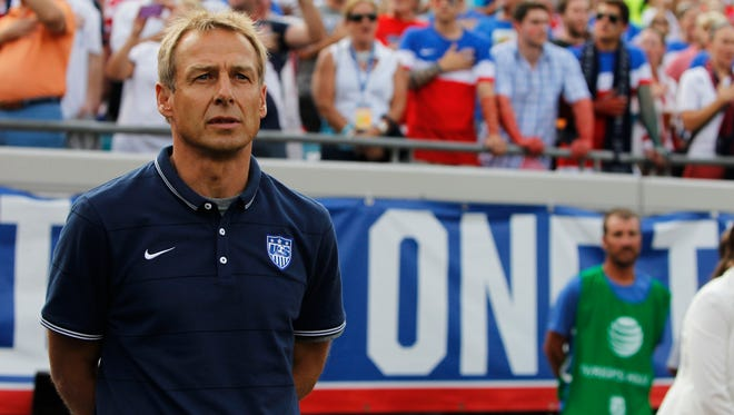 United States head coach Jurgen Klinsmann (hc) during the national anthem against the Nigeria at EverBank Field.