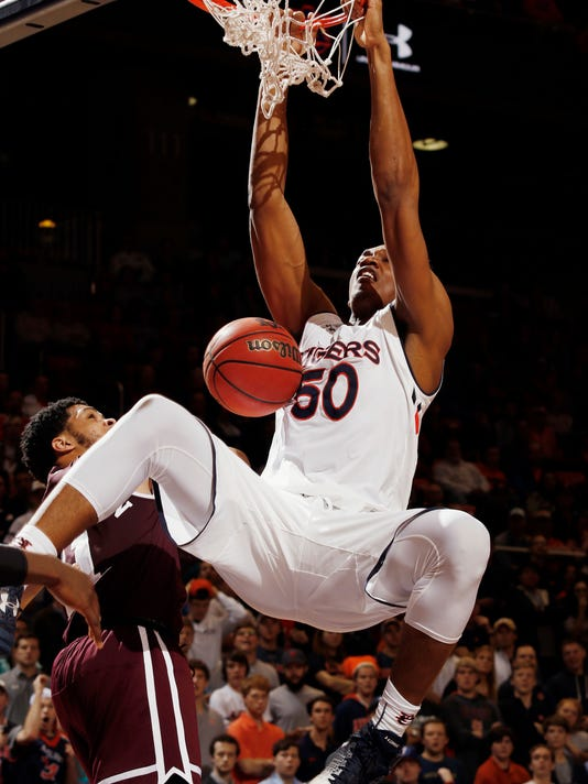 Auburn's Austin Wiley dunks against Mississippi State during the second half of an NCAA college basketball game Tuesday, Feb. 7, 2017, in Auburn, Ala. Auburn won 98-92. (Todd J. Van Emst/Opelika-Auburn News via AP)