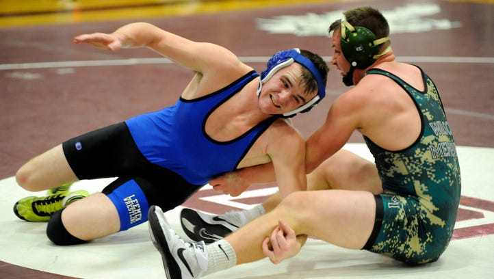Robert E. Lee's Taylor Fix gets a reversal against Wilson's Zac Denton in the 170 lbs. weight class at the 2016 Conference 36 Wrestling Championships at Stuarts Draft High School Saturday, Feb. 6, 2016. Denton won the match.
