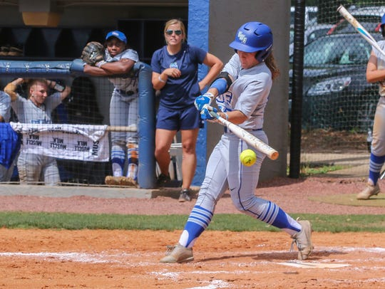 West Florida's Sara Spears (25) hits a stand-up double