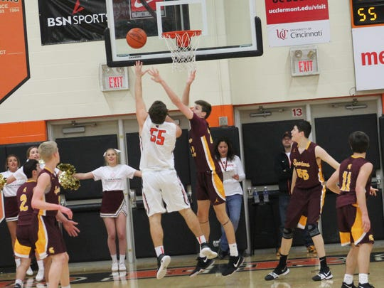 Anderson senior Nate Wilkins attempts the putback against Turpin Jan. 13.