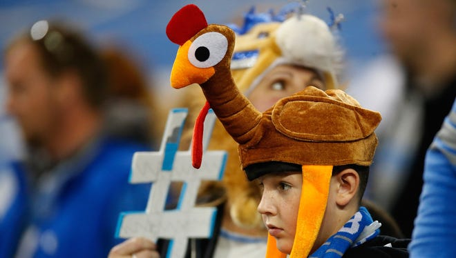 A young fan with a turkey hat looks on during the Thanksgiving day game between the Detroit Lions and Chicago Bears at Ford Field on November 27, 2014 in Detroit, Michigan.