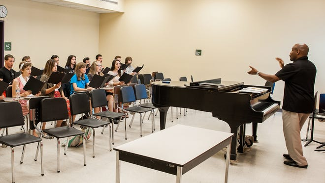 Belmont University students, along with director Jeffery Ames, right, rehearsing for the Rolling Stones concert.