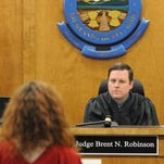 Judge Brent N. Robinson listens as he convenes drug court Thursday afternoon.