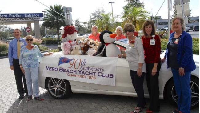 In attendance for the delivering the bears are (from left) Indian River Medical Center's Lewis Clark; hospital volunteers Bill Stewart and Beth Millan; Vero Beach Yacht Club members Carin Fedderman and Milley La Canfora; and IRMC Emergency Department staff Sheryl Murphy and Darleen Vaughan.