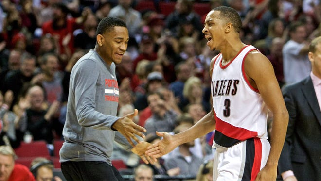 Portland Trail Blazers guard C.J. McCollum (3) and forward Maurice Harkless (4) react after a three point basket against the New Orleans Pelicans during the fourth quarter at the Moda Center on Oct. 28, 2015.