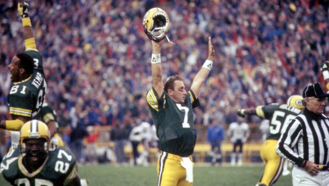 Green Bay Packers quarterback Don Majkowski (7) celebrates the instant-replay call confirming his game-winning touchdown pass to Sterling Sharpe against the Chicago Bears at Lambeau Field on Nov. 5, 1989. The Packers won 14-13. Also celebrating are, from left, receiver Perry Kemp (81), running back Herman Fontenot (27) and linebacker Johnny Holland (50).