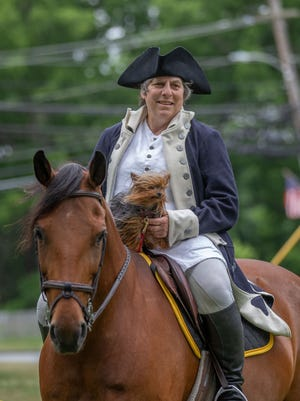 Angela Kazanovicz in costume with her horse, Aurora, and dog, Tessa, during a Fourth of July celebration on Sutton Common, Friday, July 3, 2020.