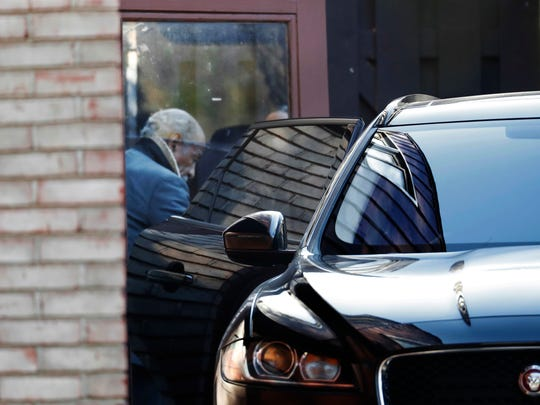 Rep. John Conyers, D-Mich., leaves his home Wednesday, Nov. 29, 2017, in Detroit. Rep. Conyers is being pressured by some in Washington to resign. Rep. Conyers recently stepped down from his post as top Democrat on the House Judiciary Committee after facing allegations of sexual harassment by former staffers.