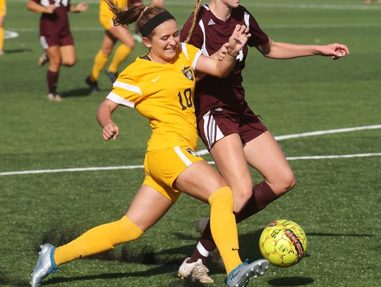 Battling for the ball Wednesday is Schoolcraft's Eliss
