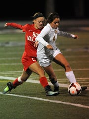 Big Walnut's Alexis Schone, left, tries to get the ball from Unioto's Sophia Garza Tuesday night, Oct. 31, 2017, during a regional semifinal game at Bloom-Carroll High School in Carroll. Big Walnut won the game 1-0.