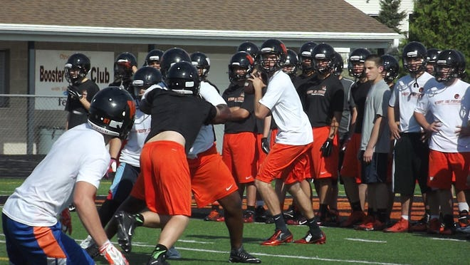 West De Pere senior Cole Kempen targets senior David Zellner on a pass play at practice Wednesday.